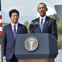 U.S. President Barack Obama speaks as Prime Minister Shinzo Abe listens at Kilo Pier overlooking the USS Arizona Memorial on Tuesday. | AFP-JIJI