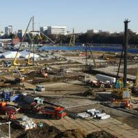 Construction work is underway on Dec. 8 at the site of the new National Stadium in Tokyo's Meiji Jingu area. It will be the main venue for the 2020 Tokyo Olympics. | KYODO