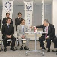 The governors of Kanagawa, Miyagi and Chiba prefectures submit a petition to Yoshiro Mori (second from right), president of the 2020 Olympic organizing committee, in Tokyo on Monday. | POOL / VIA KYODO