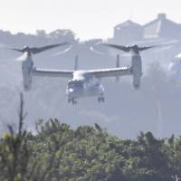 An MV-22 Osprey tilt-rotor aircraft takes off from U.S. Marine Corps Air Station Futenma in Okinawa Prefecture on Monday afternoon. | KYODO