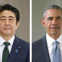 Prime Minister Shinzo Abe said Monday that he had agreed with U.S. President Barack Obama last month to visit Pearl Harbor together 'to pay tribute' to military personnel from both sides of the Pacific. | KYODO VIA GETTY IMAGES