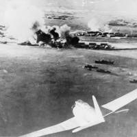 Abe's Pearl Harbor visit will do little to dispel theories persisting over the 1941 attack