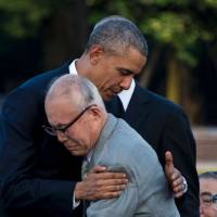 U.S. President Barack Obama hugs Hiroshima atomic bomb survivor Shigeaki Mori during a visit to the Hiroshima Peace Memorial Park on May 27. Mori has praised Prime Minister Shinzo Abe's planned visit to Pearl Harbor this month. | AFP-JIJI