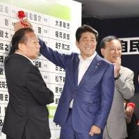 Prime Minister Shinzo Abe is all smiles after a big victory in the Upper House election in July. Whether his ruling coalition will be able to pull off another victory if a snap election is called this year remains to be seen. | KYODO