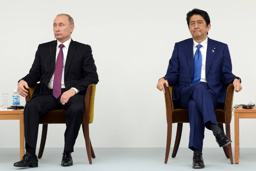 Putin claims 1956 pact does not specify sovereignty of isles: Abe
