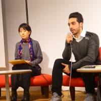Jamal (right) speaks about his life after landing in Japan at a conference in Tokyo's Shibuya Ward on Wednesday. | SHUSUKE MURAI