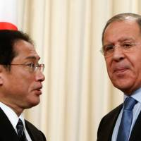 Foreign Minister Fumio Kishida speaks with Russian Foreign Minister Sergey Lavrov at a news conference in Moscow on Saturday. | REUTERS