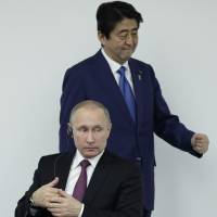 Russian President Vladimir Putin and Prime Minister Shinzo Abe attend the Japan-Russia Business Dialogue in Tokyo on Dec. 16. | BLOOMBERG