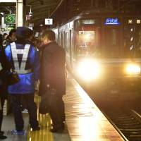 A man was arrested Tuesday on suspicion of trying to kill a woman by pushing her on a train platform at JR Sannomiya Station in Kobe. | KYODO