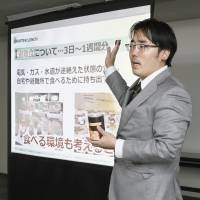 Tomoya Takani lectures on disaster prevention before members of the Saitama Municipal Assembly during a seminar held in the city on Oct. 22. | KYODO