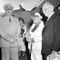Prime Minister Shigeru Yoshida, accompanied by his daughter, Kazuko, is greeted by Adm. Arthur Radford (left) commander of the U.S. Pacific Fleet, and Joseph Farrington, who served as a delegate of the U.S. Congress for the Territory of Hawaii, during an arrival ceremony for Yoshida in Honolulu, Hawaii, on Aug. 31, 1951. | AP
