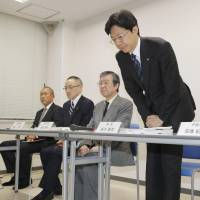 Koji Tanigawa apologizes Tuesday at a news conference in Tokyo. | KYODO