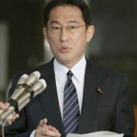 Foreign Minister Fumio Kishida speaks to reporters at the Foreign Ministry on Monday. | KYODO