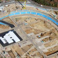 An aerial view taken Saturday shows the construction site for the new National Stadium in Tokyo. | KYODO