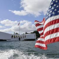 The USS Arizona Memorial in Pearl Harbor, Hawaii, is seen from a passing boat Saturday. | KYODO