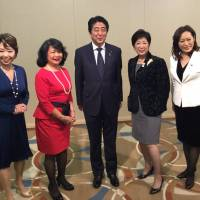 Prime Minister Shinzo Abe poses at the World Assembly for Women in Tokyo. The photo was published on Twitter by Tokyo Gov. Yuriko Koike.