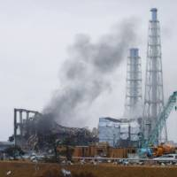 This file photo shows the crippled No. 3 reactor building at the Fukushima No. 1 nuclear power plant on March 21, 2011. | TEPCO / VIA KYODO