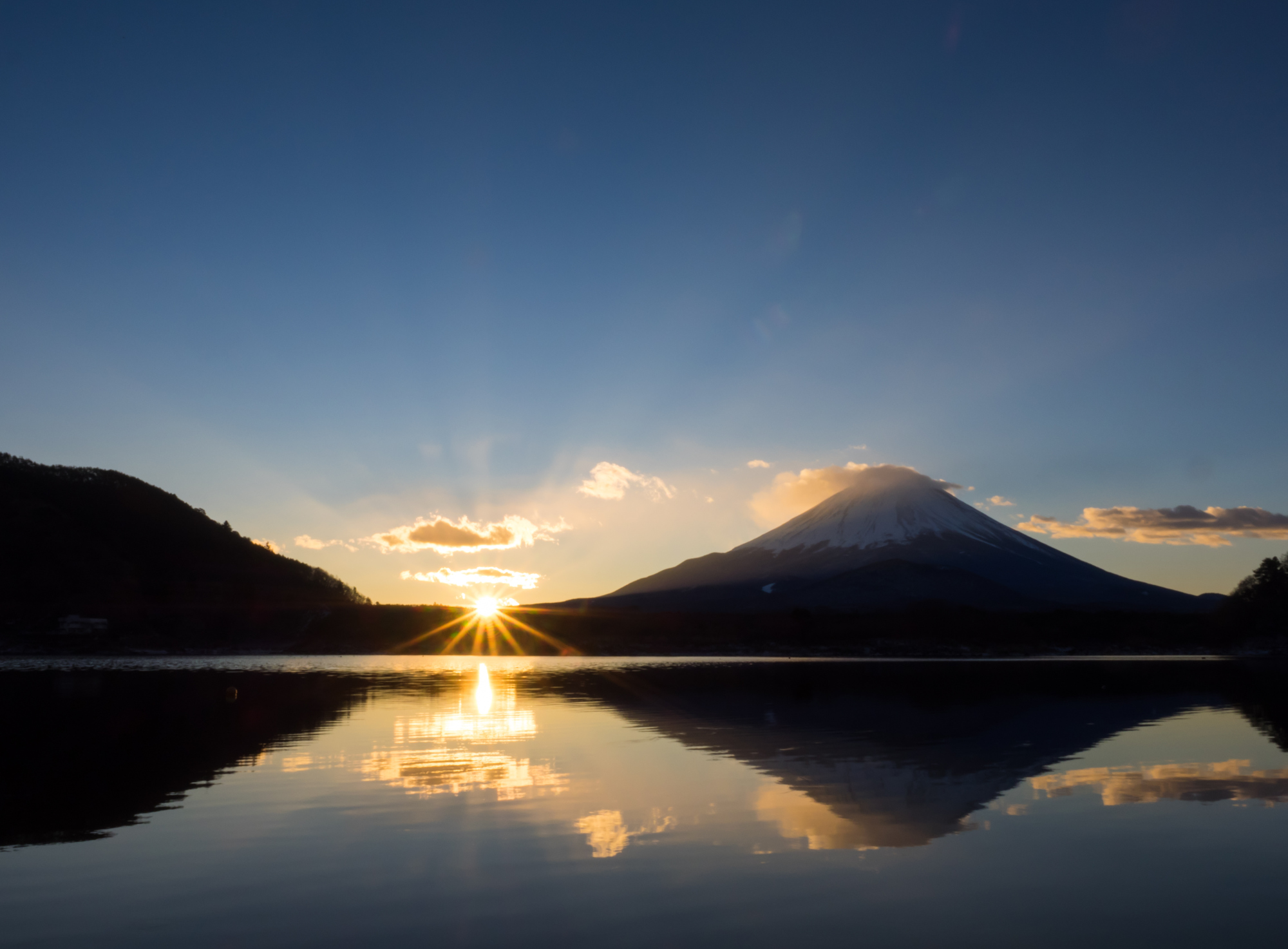 A new dawn: The sun rises by Mount Fuji one early morning in Japan. | ISTOCK