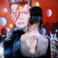 A fan pays tribute to musician David Bowie who died in January. | REUTERS