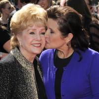 Author Carrie Fisher (right) and her mother Debbie Reynolds | AP