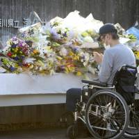 A man offers a prayer for victims of a mass killing in Sagamihara, Kanagawa Prefecture. | KYODO
