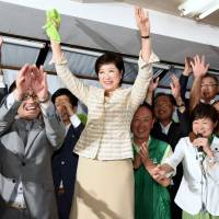Former Diet lawmaker Yuriko Koike cheers after the results of the Tokyo gubernatorial election are announced on Sunday evening. | SATOKO KAWASAKI