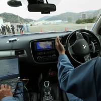 Mitsubishi demonstrates the company's self-driving car in Hyogo Prefecture. | BLOOMBERG