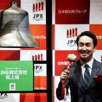 Line Corp. CEO Takeshi Idezawa poses at the Tokyo Stock Exchange. | REUTERS