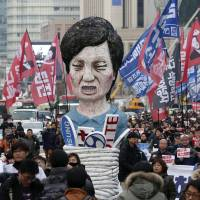 Protesters carry an effigy of South Korean President Park Geun-hye in Seoul.   AP