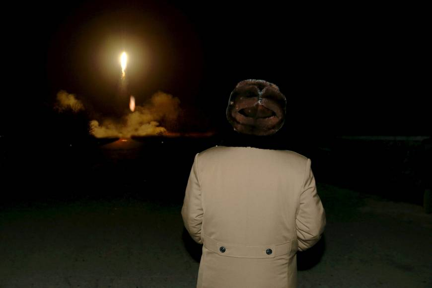 North Korean leader Kim Jong Un watches a ballistic rocket launch at an unknown location in an undated photo released in March.