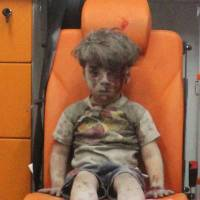 Five-year-old Omran Daqneesh sits in an ambulance after he was rescued following an airstrike on his home in Aleppo, Syria.   REUTERS