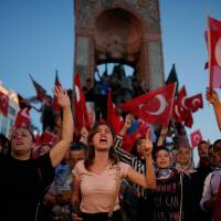 Supporters of President Recep Tayyip Erdogan rally in central Istanbul's Taksim Square on July 16 following a coup attempt.   AP