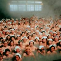 Bathers sit in a bath at Sukayu Onsen, Aomori Prefecture. | COURTESY OF SUKAYU ONSEN