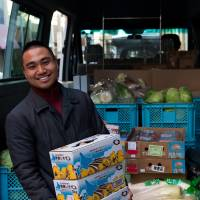 A man distributes food for Second Harvest. | COURTESY OF SECOND HARVEST