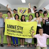 Amnesty International Japan staff pose for a group photo. | COURTESY OF AMNESTY INTERNATIONAL JAPAN