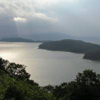 Sliver of light: The sun reflects off the water in Tamatsushima. | PUBLIC DOMAIN