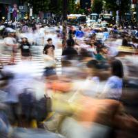 Pedestrians on a busy intersection in Tokyo | ISTOCK