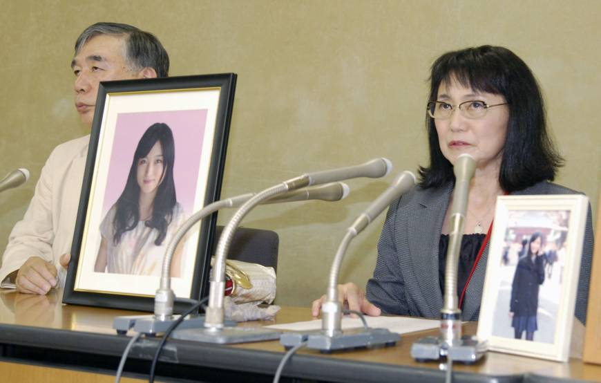 Yukimi Takahashi, mother of Matsuri Takahashi, speaks to reporters at the health ministry in October. | KYODO