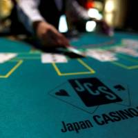 Knowing when to walk away: A dealer puts cards on a mock blackjack casino table at an international tourism promotion symposium in Tokyo in September 2013. | REUTERS