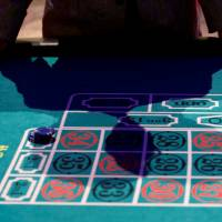 Knowing when to walk away: A visitor puts his hands on a mock casino roulette table at an international tourism promotion symposium in Tokyo in September 2013.  | REUTERS