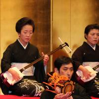 A delicate tune: Women play a shamisen during a performance of the 'Nagauta Samon-kai' at Uchisaiwaicho Hall in Tokyo on Dec. 16, 2016. The three-stringed instrument is facing a crisis amid a backlash over its use of cat and dog skins to cover its body and a decline in craftsmen able to carry on its manufacturing traditions. | KYODO