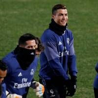Real Madrid's Cristiano Ronaldo (center) and teammates participate in a Saturday training session. | REUTERS