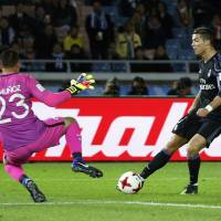 Real Madrid's Cristiano Ronaldo scores in the 93rd minute against Club America in the Club World Cup semifinals on Thursday at Nissan Stadium. Real Madrid defeated Club America 2-0. | REUTERS