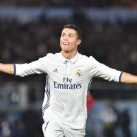 Real Madrid's Cristiano Ronaldo celebrates after scoring against Kashima during extra time of Club World Cup final on Sunday. | AFP-JIJI