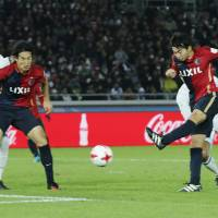 Kashima's Gaku Shibasaki scores in the Club World Cup final against Real Madrid in Yokohama on Sunday. Madrid won 4-2 after extra time. | AP