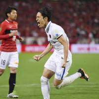 Kashima's Mu Kanazaki jubilates after scoring on a penalty in the 79th minute for his second goal of the game.   KYODO