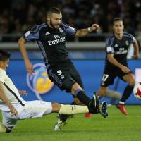 Real Madrid's Karim Benzema scores a first-half goal against Club America on Thursday.   REUTERS
