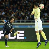Real Madrid's Marcelo shoots over Club America's Bruno Valdez in Club World Cup action on Thursday.   AP