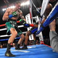 Smith brings end to Hopkins' long career with TKO in eighth round