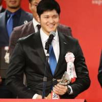 Hokkaido Nippon Ham Fighters star Shohei Otani, the winner of the Pacific League's MVP Award this season, is hoping to add the wins, ERA and strikeout titles to his resume in the future. | KYODO